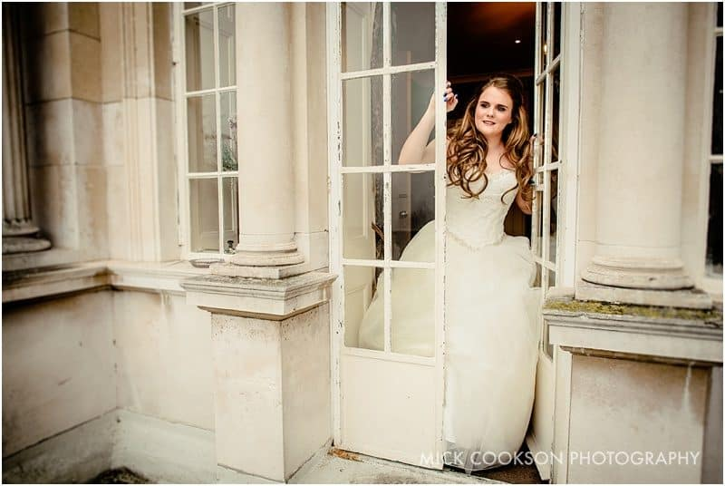 bride on the balcony at eaves hall