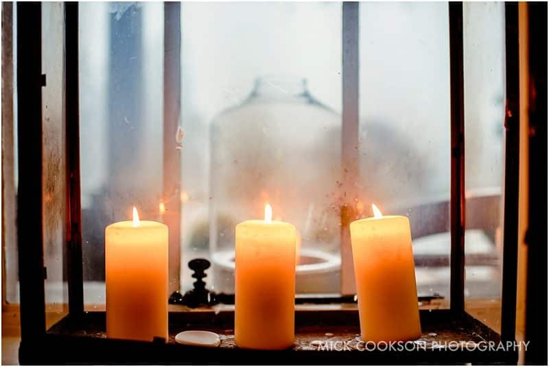 candles at an eaves hall winter wedding