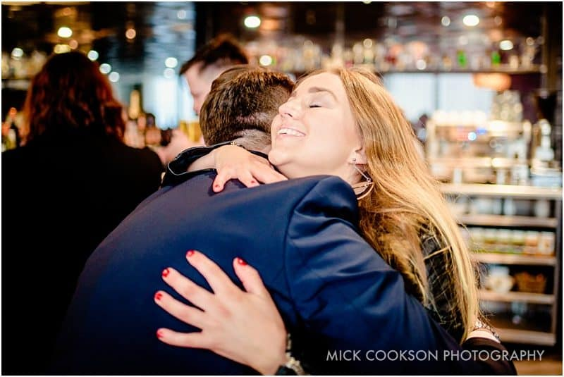 guests hugging at a manchester wedding