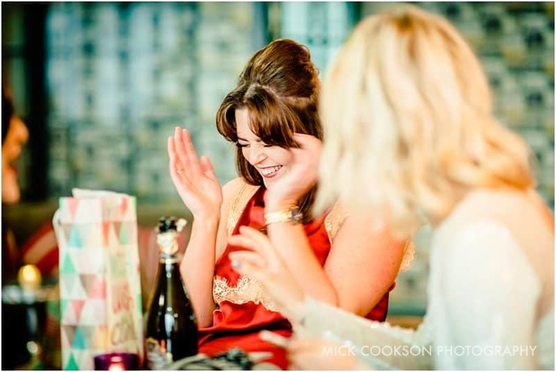 female wedding guest laughing