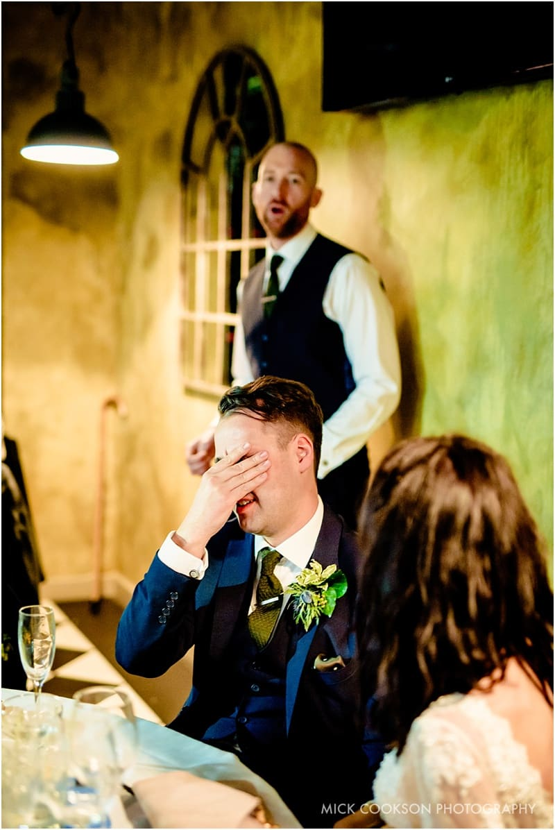 embarrassed groom at on the 7th