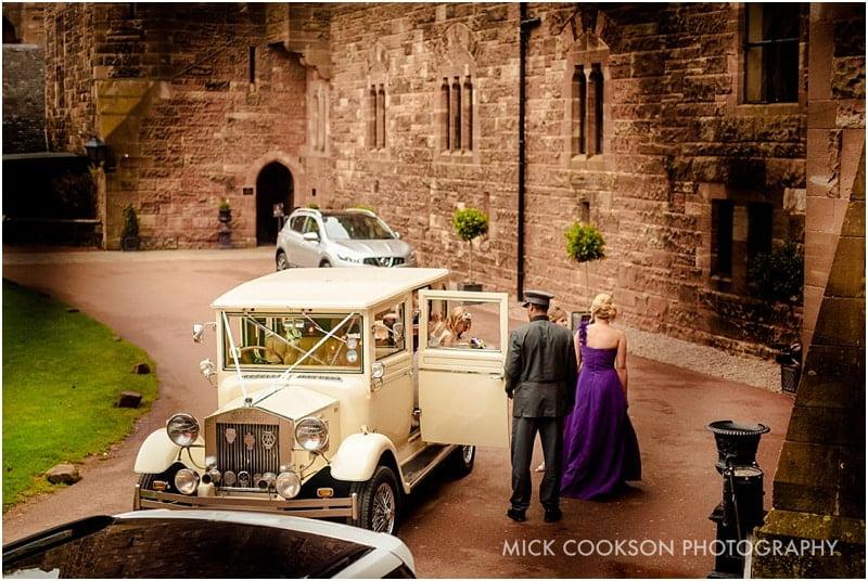 bride arrives in car at peckforton castle