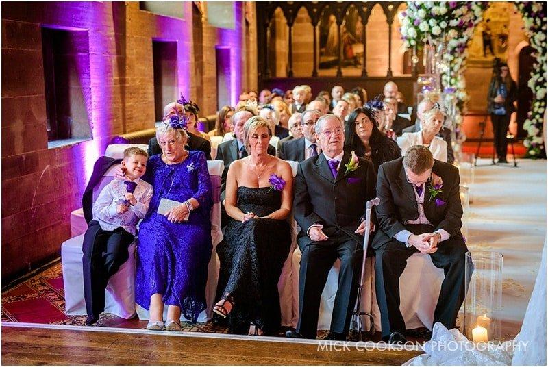 wedding guests at peckforton castle