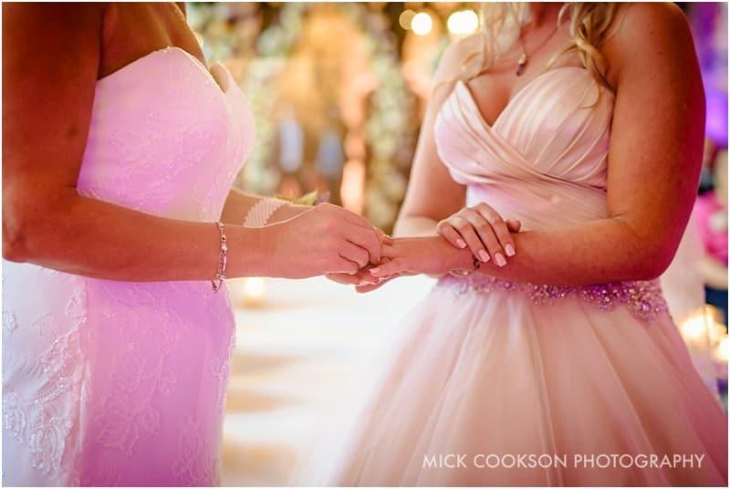 putting brides ring on finger at peckforton castle