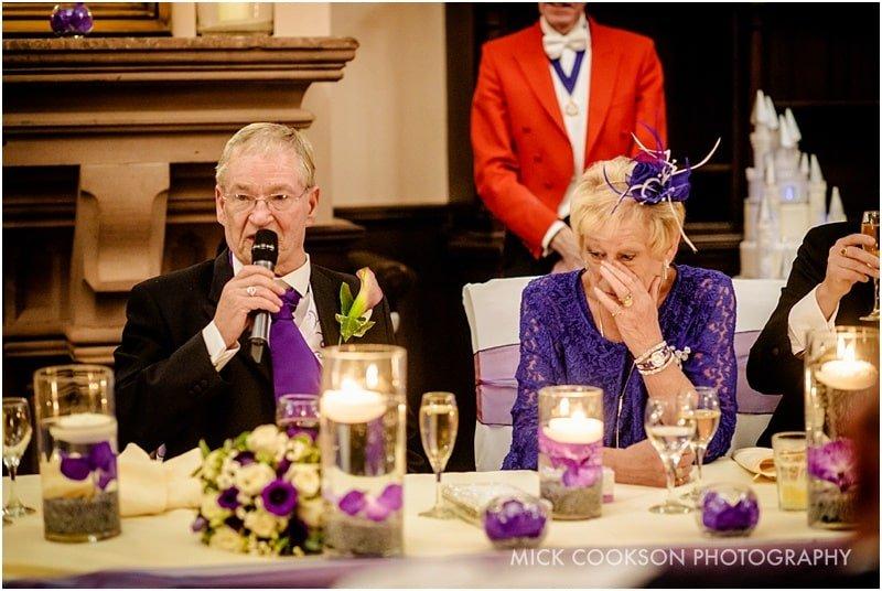 emotional parents at a same sex wedding