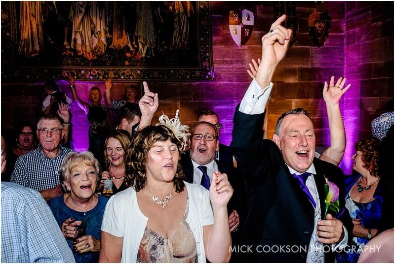 wedding guests dancing at peckforton castle