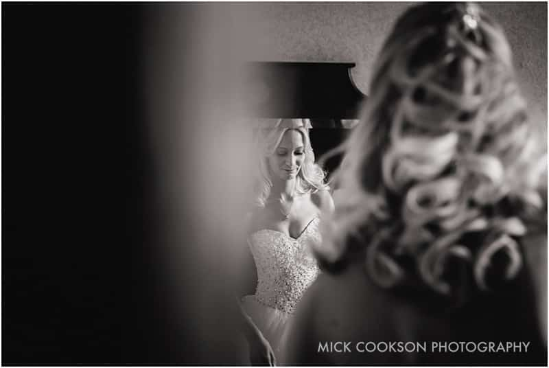 bride reflected in a mirror at shrigley hall