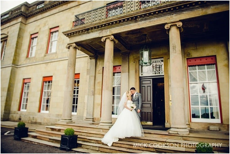 formal photos on steps at shrigley hall