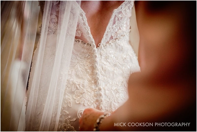 wedding dress being fastened up