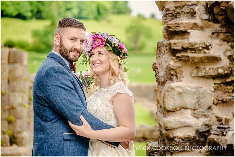 bride and groom at sawley abbey ruins