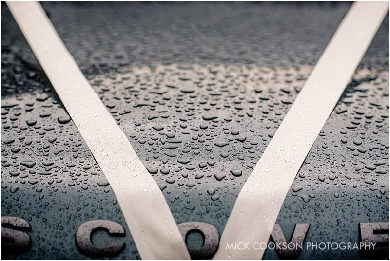 rain on a wedding car