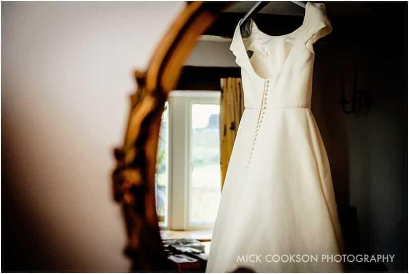 wedding dress in a farmhouse