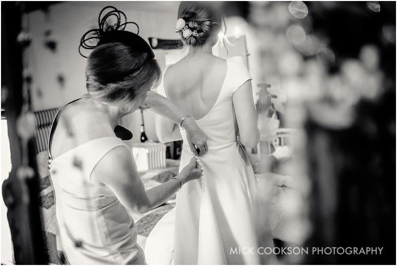 fastening the wedding dress