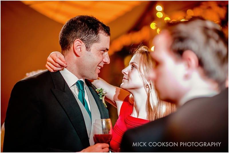 wedding guests smooching