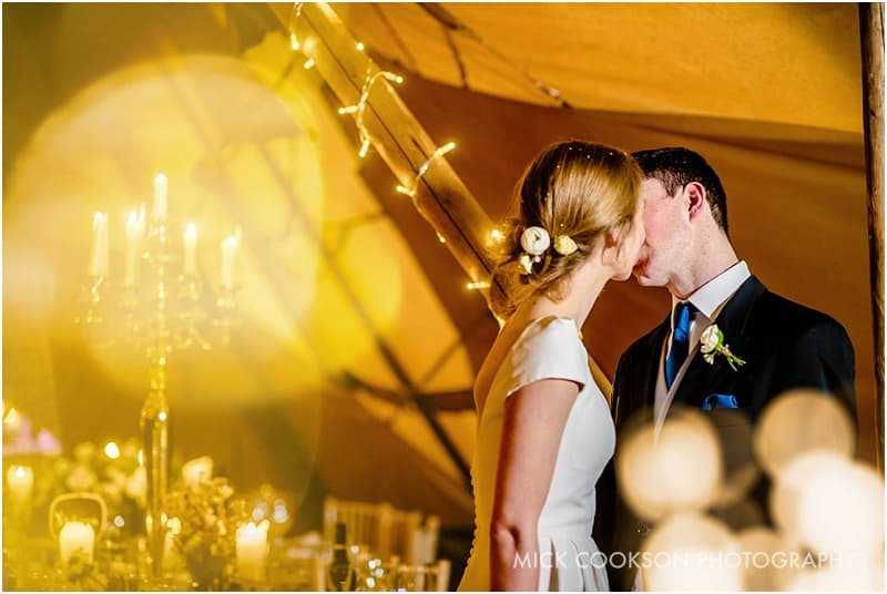 bride and groom in a tipi
