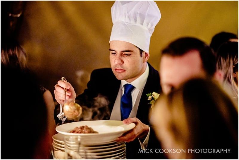 tabke chef serving at a tipi wedding