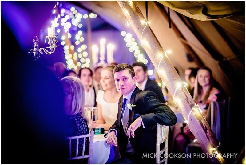 groom at a tipi wedding