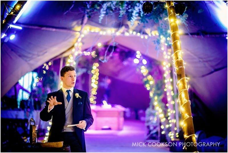 groom speech inside a tipi wedding tent