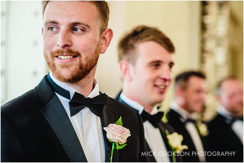 groomsmen in tuxedo suits