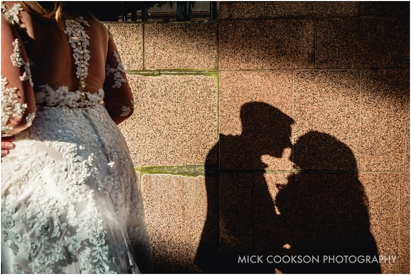 shadow of a bride and groom on a wall
