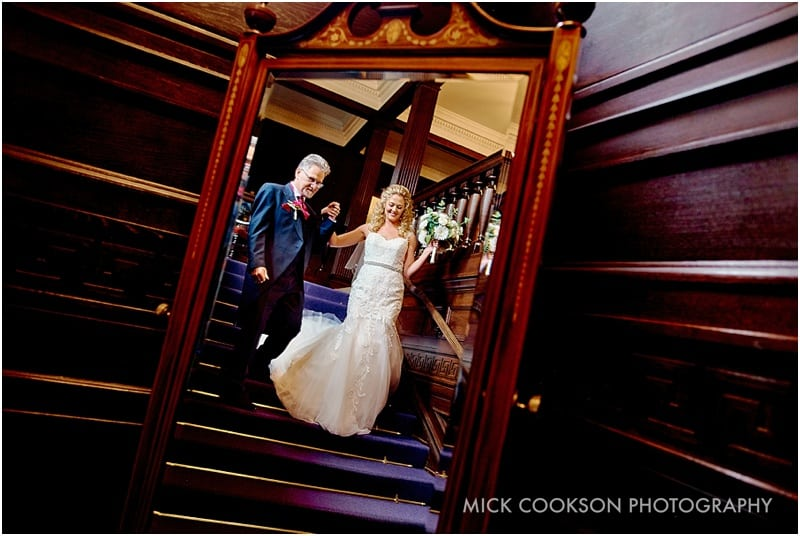father of the bride reflected in a mirror at eaves hall