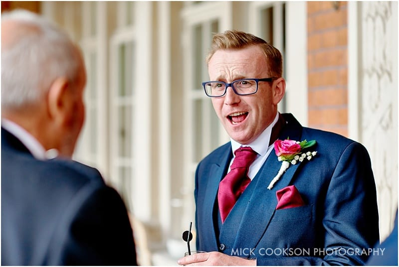 wedding guest telling a joke