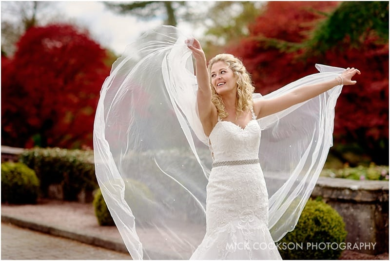 bride being an angel with her veil