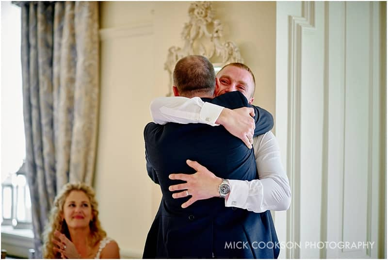 emotional groom hugs his brother
