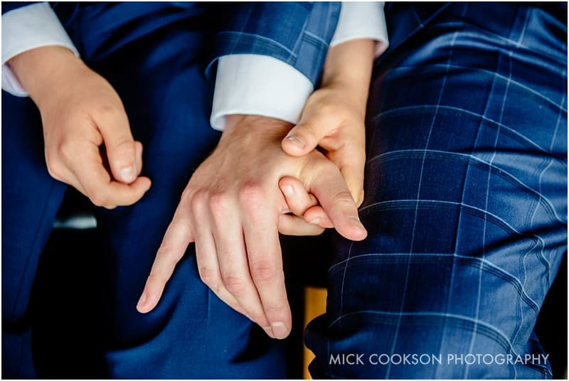 groom holding his son's hand