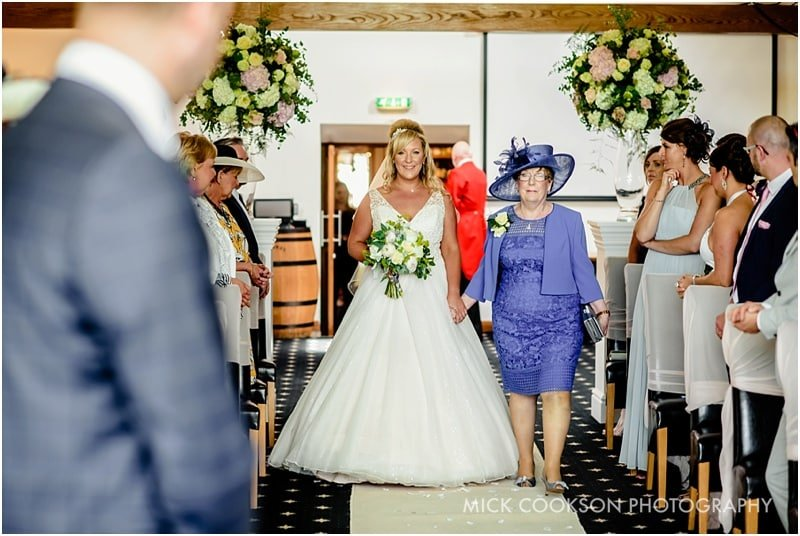 bride walks down the aisle at the fisherman's retreat