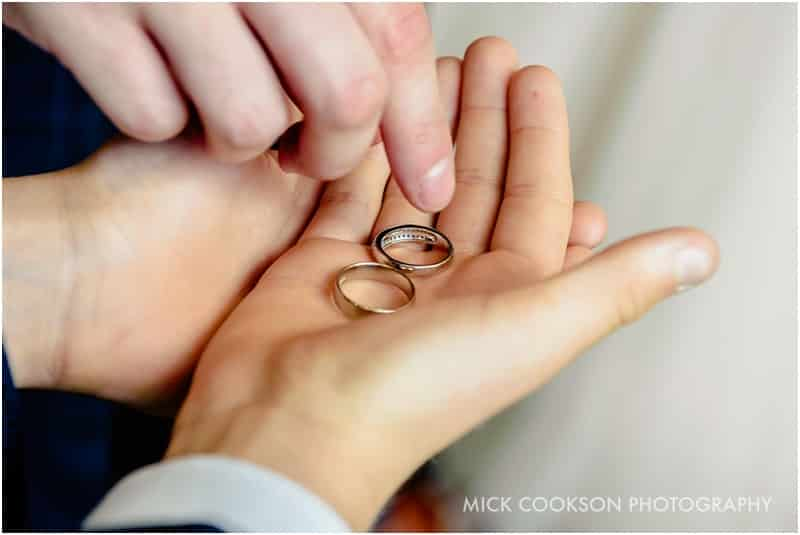 wedding rings being handed over