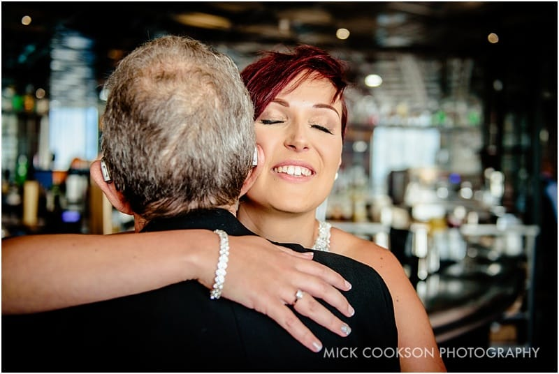 bride hugs her grandfather