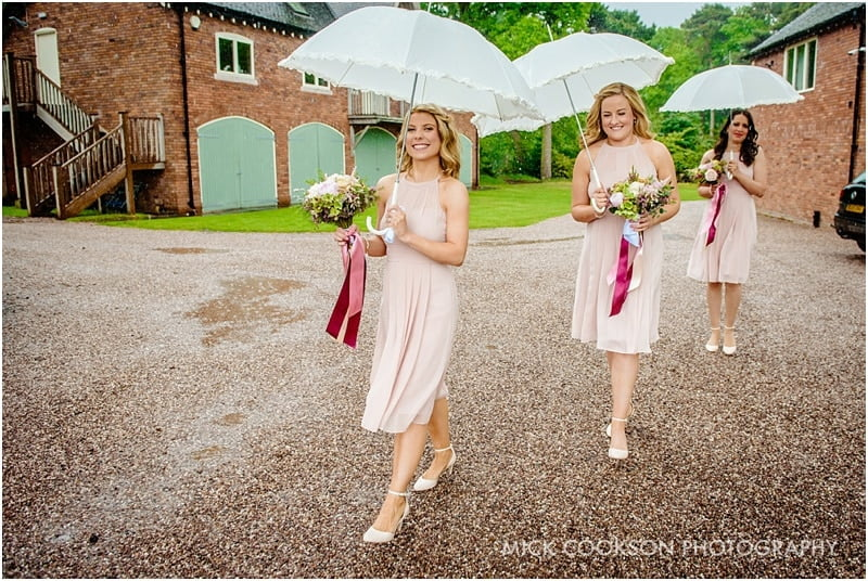 bridesmaids in the rain at abbeywood estate gardens