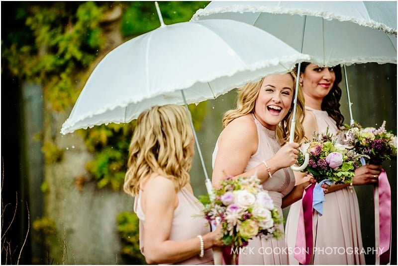 bridesmaid laughing in the rain