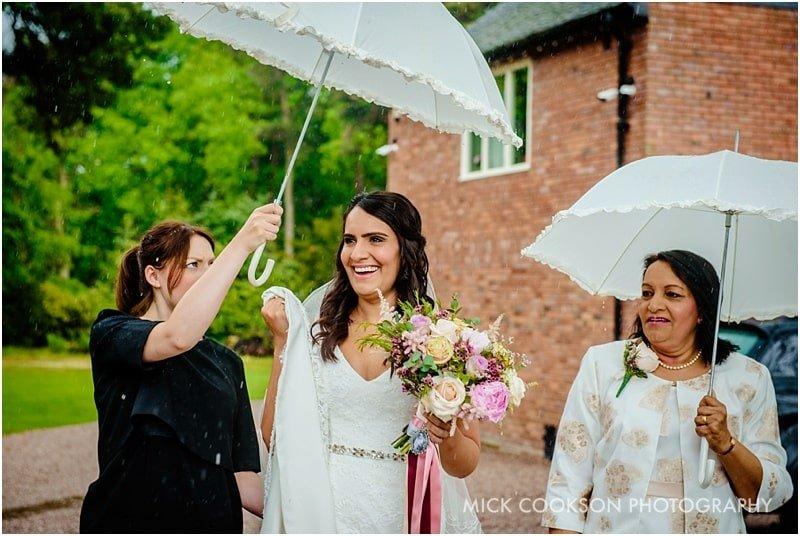bride walking in the rain