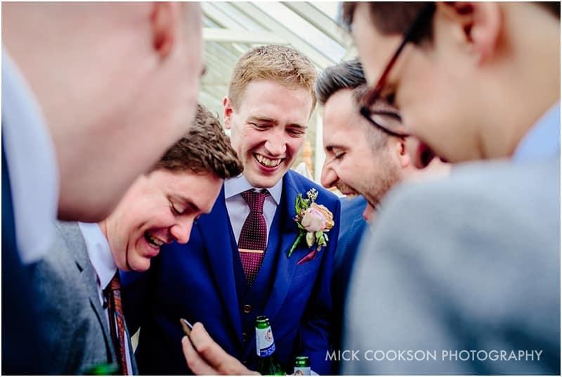 groomsmen sharing a joke