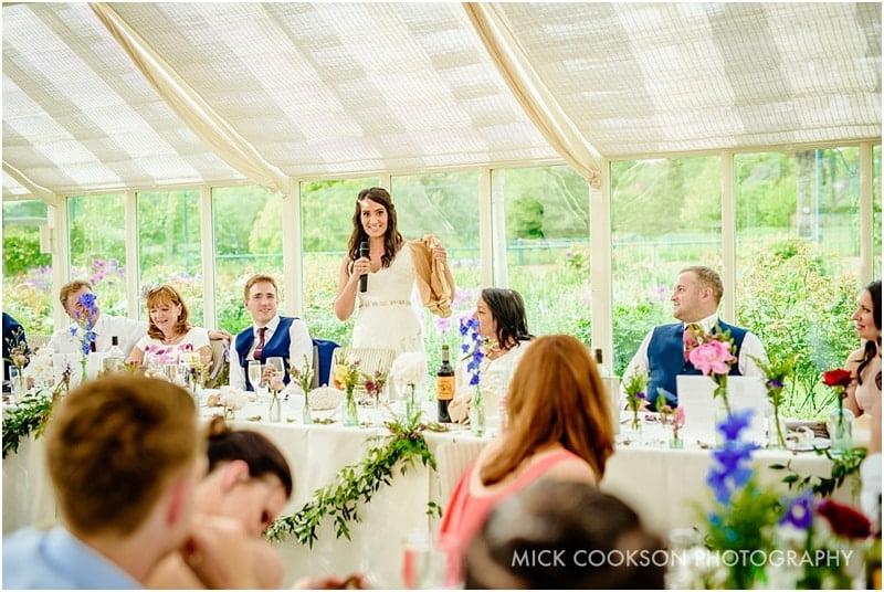 bride speaking at abbeywood estate gardens