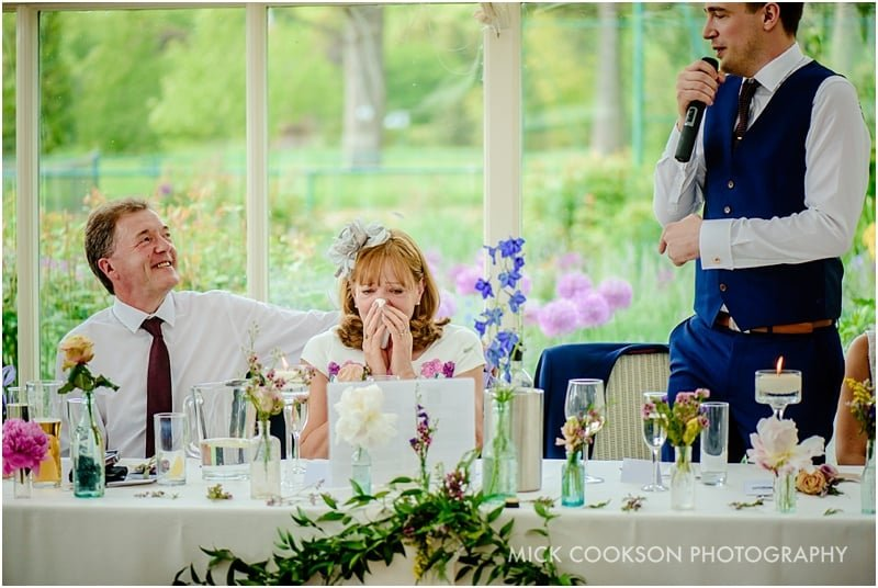 emotional parents at a wedding
