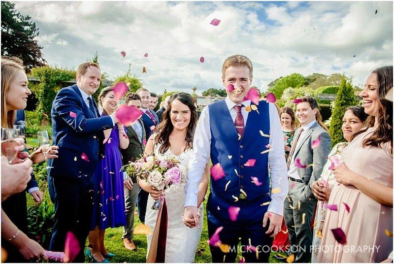 throwing confetti at abbeywood estate gardens
