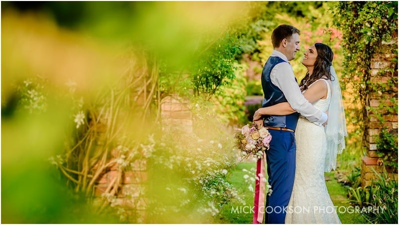 bride and groom in abbeywood estate gardens