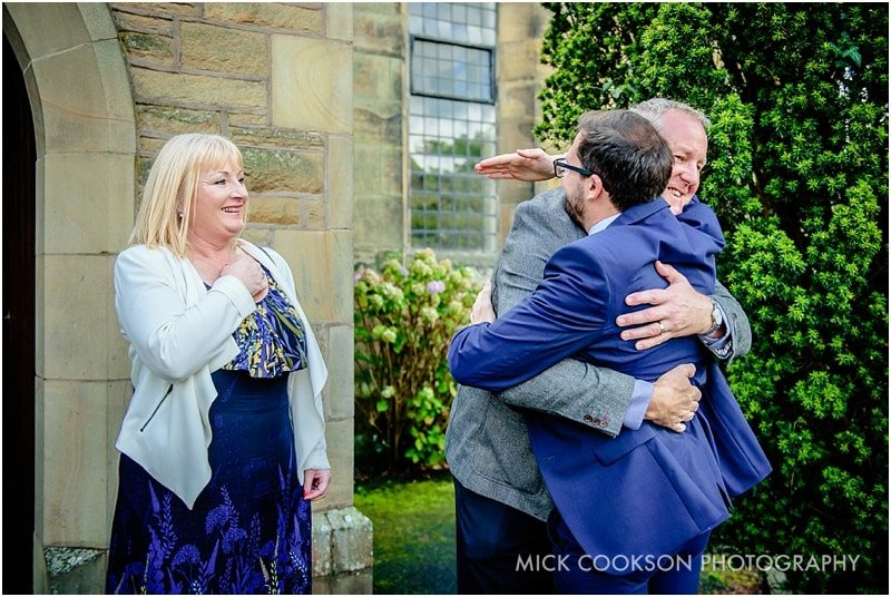 wedding guests hugging in preston