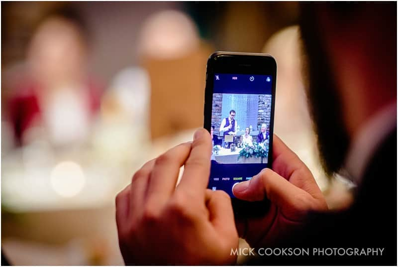 groom speech at bartle hall on mobile phone