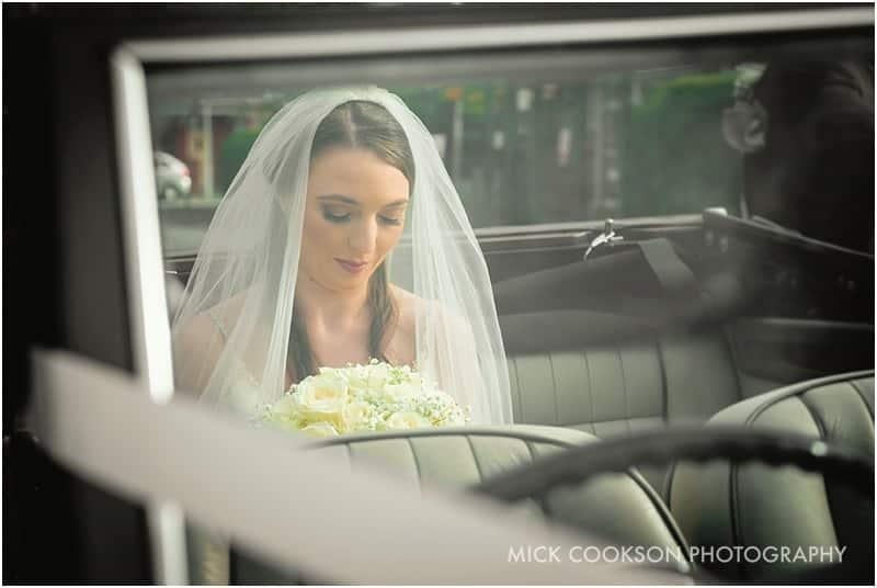 pensive bride in a wedding car
