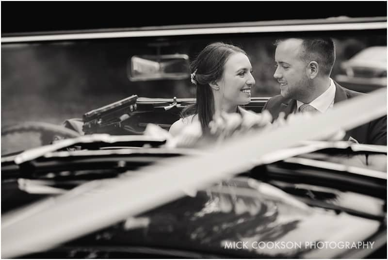 bride and groom in a malvern wedding car