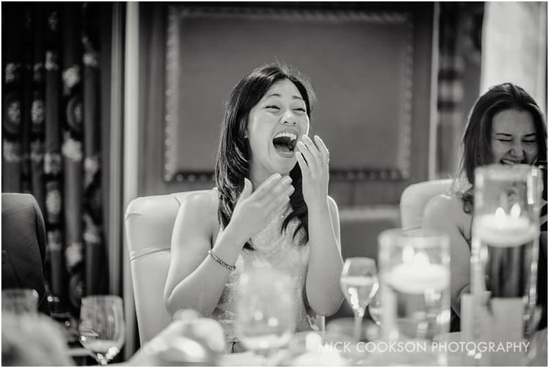 laughing chinese wedding guest