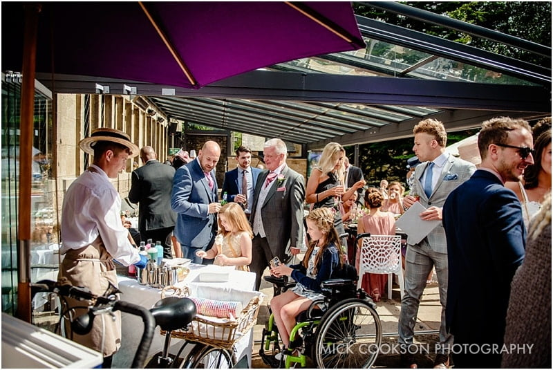 wedding guests in the sunshine at rivington hall barn