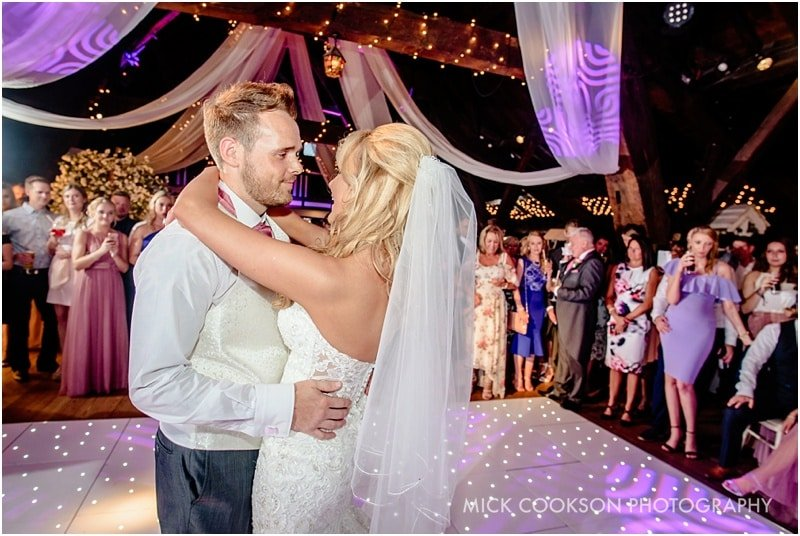 bride and groom first dance at rivington hall barn