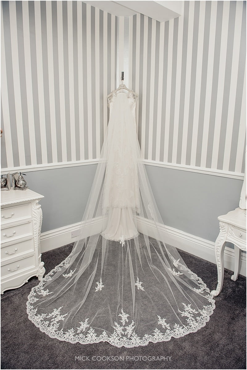 a wedding dress hanging up at stirk house