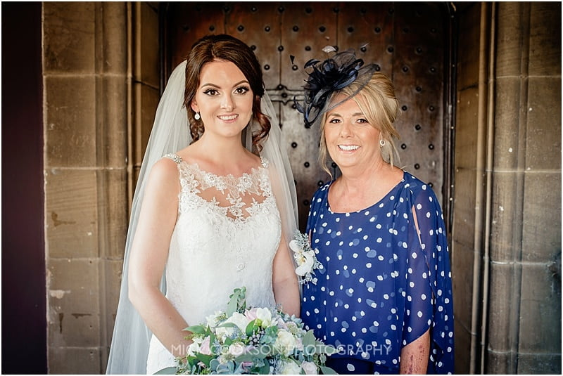 bride and her mum smiling
