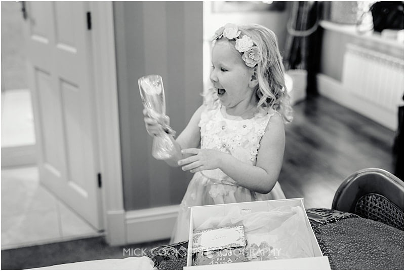 flower girl opening her present
